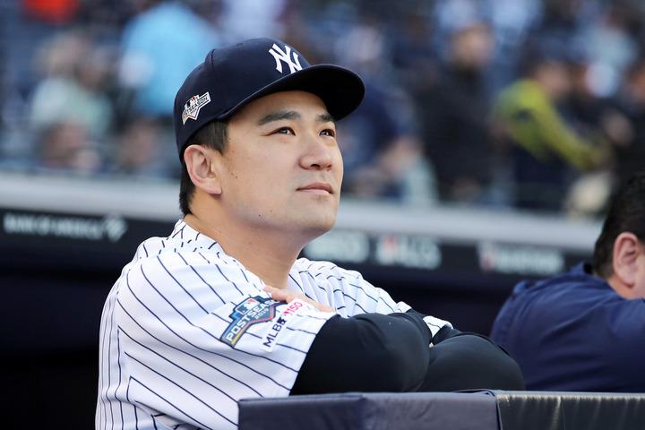 田中は「お気に入りの写真」と題し、里田夫人との仲睦まじい2ショットを公開した。(C)Getty Images