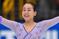 バンクーバー五輪銀メダリストの浅田さんがキュートなエプロン姿を披露した。(C)Getty Images