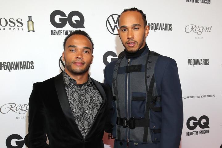 障がいとともに自らの人生を歩む弟ニコラス(左)と、常に温かい心でそれを見守るルイス(右)。(C)Getty Images