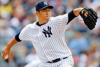 黒田はボーイズリーグ時代、元プロ野球選手の父から監督として指導を受けていた。写真:Getty Images