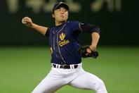 「ジャスティス」の異名を取り、ドラフトでは5球団が競合した田中。プロでは苦しんでいるが、大学時代の投球は圧巻だった。写真:朝日新聞社