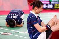 マッチポイントを握り合う激戦を制した韓国ペア。勝利の瞬間にコートへ倒れ込んだ。(C)Getty Images